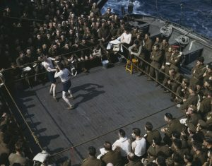 [British soldiers watching a boxing match aboard boat from England to North Africa], 1943.