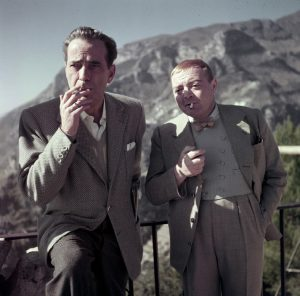 [Humphrey Bogart and Peter Lorre on the set of Beat the Devil, Ravello, Italy], 1953.