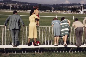 [Spectators at the racetrack, Deauville, France], August 1951.